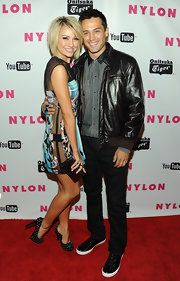 Chelsea Kane accessorized her stunning print dress with a graphite acrylic box clutch.