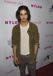 Avan Jogia look cool and casual in an olive green suede jacket at The Annual May Young Hollywood Issue party.