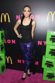 Naima Mora spruced up her simple top with a pair of iridescent purple harem pants.