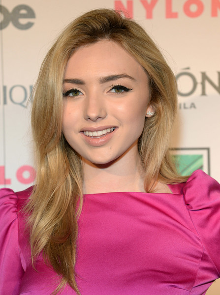 Peyton List wore her hair down with a side part and subtle waves during the Nylon Nights Los Angeles.