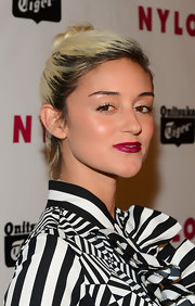 Caroline D'Amore rocked a twisted top knot for a cool and casual red carpet look.