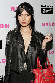Hannah added a cool black bandana headscarf with a silver disc detail for her boho-meets-biker look at Nylon's red carpet event.