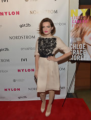 Roxane Mesquida's fit-and-flare dress featured a lace-embroidered bodice and satin belt for a retro-inspired red carpet look.