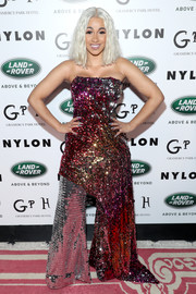 Cardi B brought a high dose of sparkle to Nylon's Rebel Fashion party with this strapless sequin hybrid gown by Halpern.