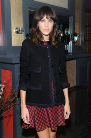 Alexa Chung looked classic in a navy tweed jacket layered over a print dress while celebrating her Nylon cover.