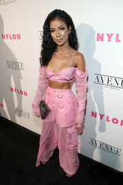 Jhene Aiko matched her top with a pair of semi-sheer pink cargo pants, also by MISBHV.