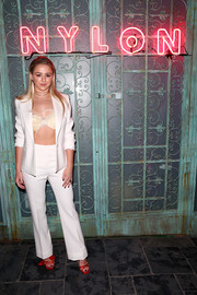 Chloe Lukasiak looked sharp in a white 3.1 Phillip Lim pantsuit teamed with a feathered bra at the Nylon Young Hollywood party.