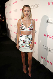 Delilah Belle Hamlin tied her look together with a pair of strappy pink sandals.