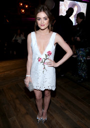 Lucy Hale completed her look with silver pumps by Brian Atwood.
