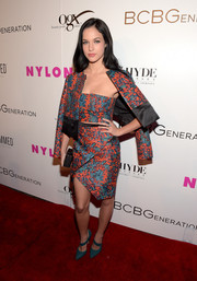 Alexis Knapp chose an ultra-modern teal and orange skirt suit for the Nylon Young Hollywood Party.