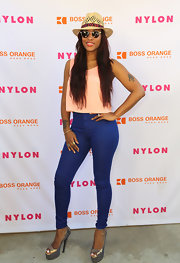 Eve showed off her long legs with these electric blue skinny pants.