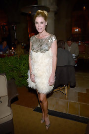 Julie Bowen added another shiny element to her look with a pair of silver metallic peep toe pumps.