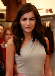 Camilla Belle added some length to her shoulder length tresses. Large curls completed her side swept locks.