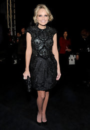 Kristin Chenoweth wore this heavily beaded black dress to the Naeem Khan fashion show.