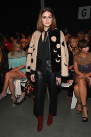 Olivia Palermo looked perfectly put together in her leather pants, tie-neck blouse, and fur jacket ensemble.