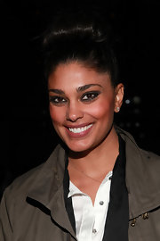 Rachel Roy wore an updated version of the classic bun to the Naeem Khan fashion show. To try her look, backcomb hair, then smooth slightly while pulling up into a ponytail on top of the head. Twist the ponytail loosely and wrap it around the base of the tail. Finish by securing the bun in place with bobby pins.