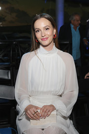Leighton Meester accessorized with a marbled ivory box clutch by Edie Parker when she attended the Naersi fashion show.