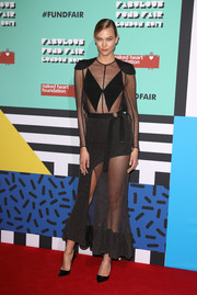 Karlie Kloss was edgy-sexy at the Fabulous Fund Fair in a sheer black Louis Vuitton dress with strategically placed solid panels.