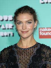 Arizona Muse kept it relaxed with this messy updo at the Naked Heart Foundation's Fabulous Fund Fair.