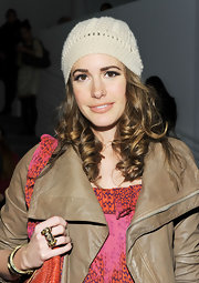 Louise Roe played up her natural good looks with soft pink lipstick.