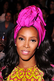 June Ambrose wore a pink silky turban-like headband at the Spring 2013 MBFW.