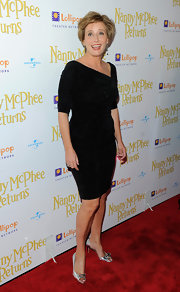 The actress looked elegant in a fitted black cocktail dress with metallic peep toe pumps.