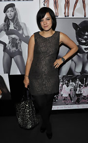 Lily Allen wore an embroidered sheath to the Dolce & Gabbana party. She paired her look with black tights and pumps.