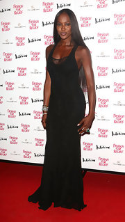 Naomi Campbell looked dramatic on the red carpet of the Olympic Celebration Dinner in this black floor-sweeping gown.