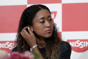 Naomi Osaka accessorized with an elegant silver watch while attending a press conference in Japan.