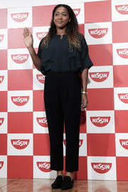Naomi Osaka teamed her top with basic black slacks.