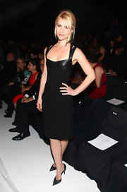 Claire topped off her fitted black frock with black d'orsay stilettos.