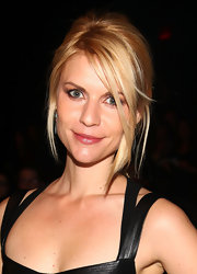 Claire Danes attended the Narcisco Rodriguez fall 2012 fashion show wearing her hair in a casual updo featuring long bangs and face-framing strands.