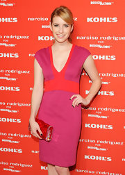 Emma Roberts color-blocked her alright bright look with shiny this red and pink clutch.