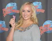 Nastia Liukin wore a Superman pendant necklace during a visit to Planet Hollywood.