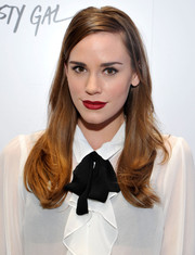 Christa B. Allen wore her tresses with a deep side part and flippy ends during the Nasty Gal Melrose store launch.