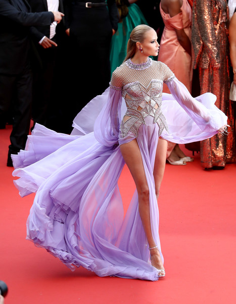 Natasha Poly Cutout Dress [red carpet,carpet,dress,pink,fashion,flooring,hairstyle,premiere,gown,event,red carpet arrivals,natasha poly,blackkklansman,screening,cannes,france,cannes film festival,palais des festivals]