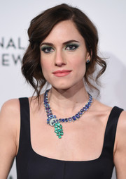 Allison Williams accessorized with a gemstone statement necklace by David Webb for an ultra-glam finish.