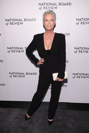 Jamie Lee Curtis added a bright spot with a white envelope clutch.