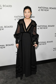 Awkwafina oozed elegance wearing this black sheer-panel gown by Elie Saab at the National Board of Review Awards Gala.