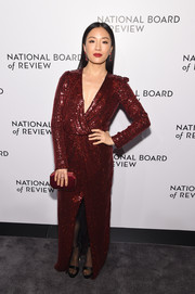 Constance Wu glittered in a red sequined wrap gown by Galvan at the National Board of Review Awards Gala.
