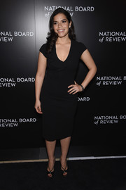 America Ferrera opted for a pair of strappy black peep-toes to complete her look.