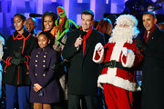 Sasha Obama looked very classy at the Christmas Tree Lighting ceremony in her navy trenchcoat.