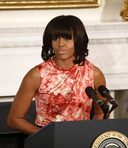 Michelle Obama chose a lovely sleeveless floral top for the National Governors Association meeting at the White House.