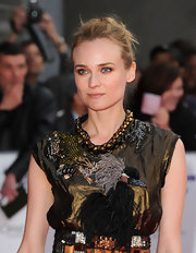 Diane Kruger paired her Lanvin confection with a loose classic bun.
