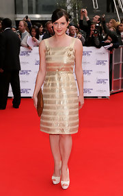 Michelle Ryan paired her Dona Karan pumps with a metallic gold dress.
