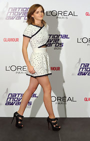 "Emma looked chic and age appropriate in a cutout romper and fabulous platform ""Miss Butterfly"" ankle booties."