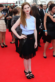 Bonnie donned a black leather clad pleated knee-length dress with her baby blue top for the National Movie Awards.