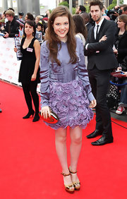 Georgie looked cute and youthful at the National Movie Awards in a purple cocktail dress with lace applique.