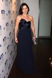 Davina McCall looked darling in a bow-embellished navy strapless gown at the 2010 National Television Awards.