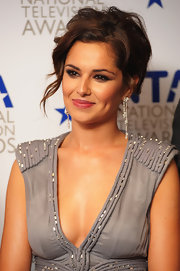 Cheryl never hesitates to update her look with a fresh 'do. A loose updo completed her plunging neckline.